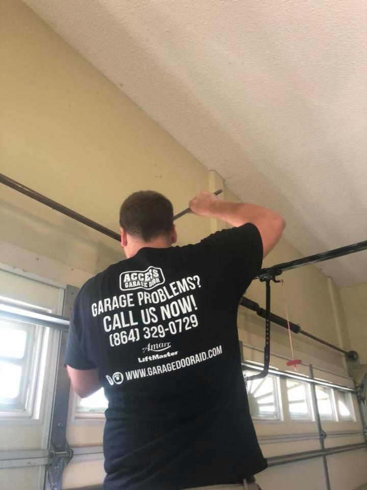 matt fixing a garage door spring